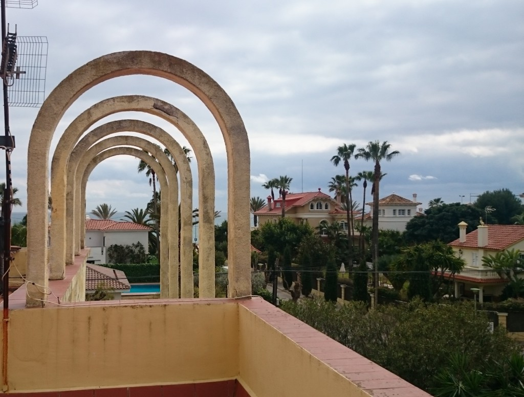 Looking out to the sea from the round arch at the roof terrace, Villa Concepción & Villa Isla Cozumel can be spotted rising up majestically.